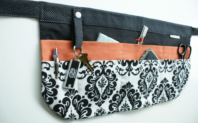 Utility Apron/Half Apron with 8 pockets and loop in black white damask and orange fabric. $35.00, via Etsy.