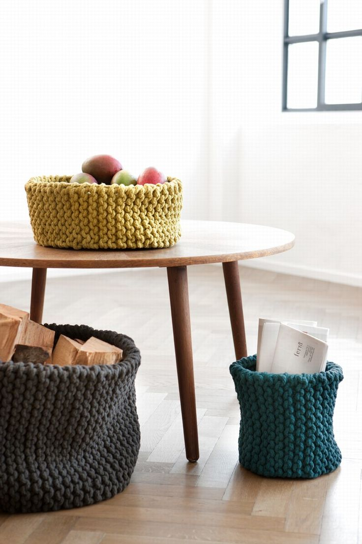 Knit baskets!!! I want the big one it teal blue to roll my extra blankets into