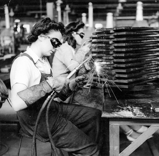 Two young women oxy welding parts of ammunition boxes in South Australia in 1943.