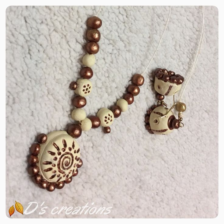 White and bronze Terracotta jewelry necklace and Jhumki set.