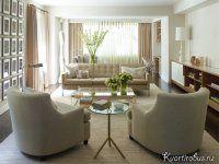 На фото характерное для гостиной в американском стиле расположение мебели в центре комнаты