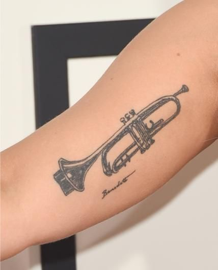 Lady Gaga wasn't born this way. She decided to permanently stamp a trumpet on her arm just last summer.