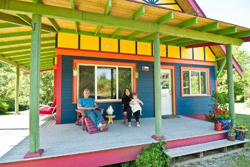 Small, Vivid Island Home in Washington.    Affectionately called the Salsa House for the salsa made on the property, this bold-colored home lives up to its lively nickname. Salvaged materials from around the neighborhood give the interior character, while the vivid exterior speaks for itself.