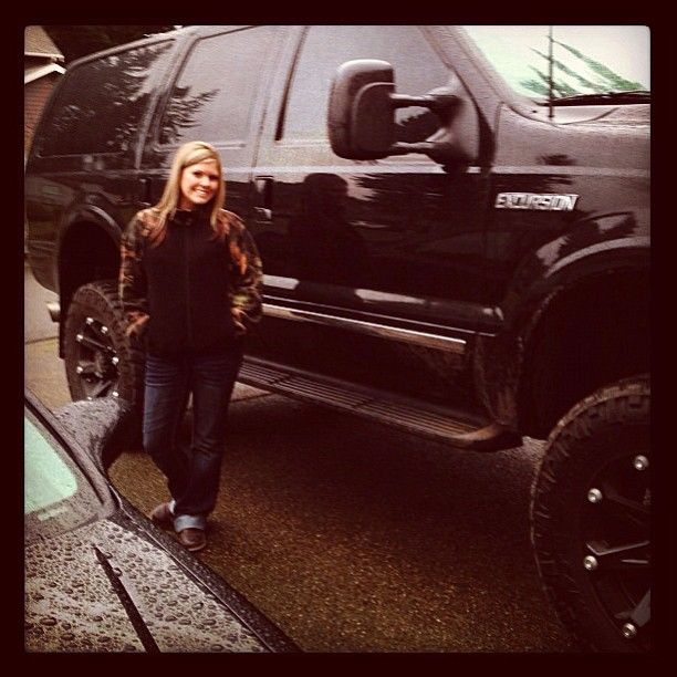 Okay. Okay. So it's a lifted Ford Excursion so technically ... whatever. She's too dang cute not to post with her bad ass black Excursion. Nice ride.