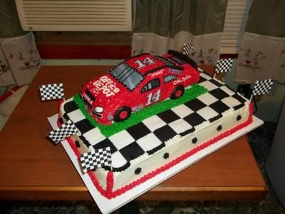 NASCAR Cake: The base of this NASCAR cake is made with 2 boxes of yellow cake mix.  The car is made with 2 boxes of pound cake.  I stacked the 2 pound cakes together