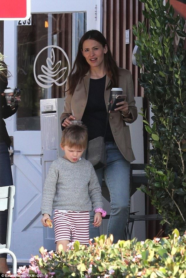 Upbeat: Jennifer Garner, 44, runs errands with her son Samuel in Brentwood, California just one day after she and ex Ben Affleck put on a happy display at Church