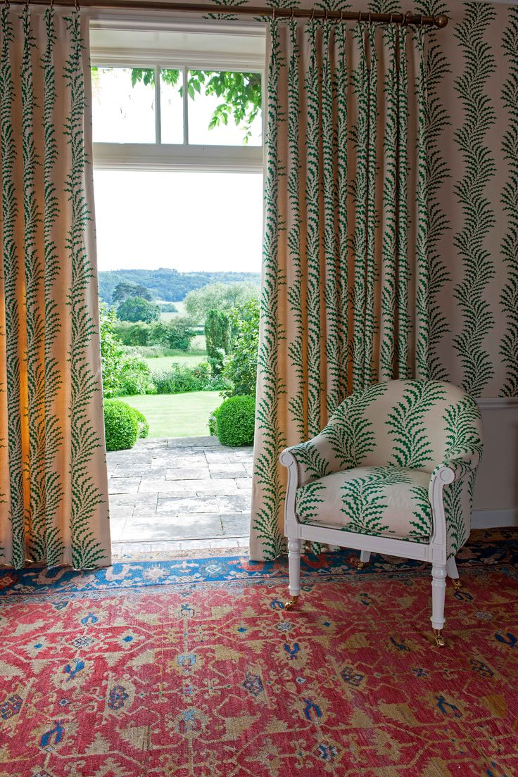 Soane Britain's spring 2017 designs include The Spoonbill Chair upholstered in Scrolling Fern Frond in emerald with matching wallpaper and curtains shown here. #SoaneBritain