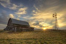 Sunset Yard, and old barn and windmill at sunset in Saskatchewan Canada
