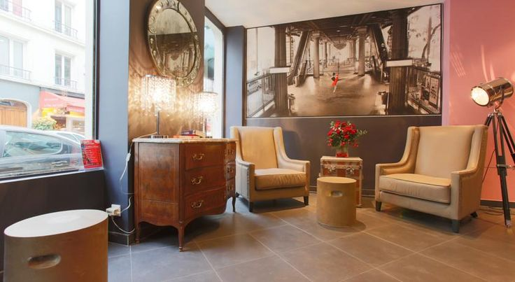 Atelier Saint Germain Hotel Paris This hotel is located in the lively Montparnasse district, 250 metres from the Montparnasse Tower. It has a 24-hour reception and offers guest rooms decorated with modern photography.  A minibar and a TV are provided in the air-conditioned rooms.