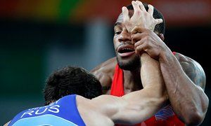 Jordan Burroughs, right, of the USA in action against Russia's Aniuar Geduev during the men's freestyle wrestling 74kg quarter-final at Rio 2016.