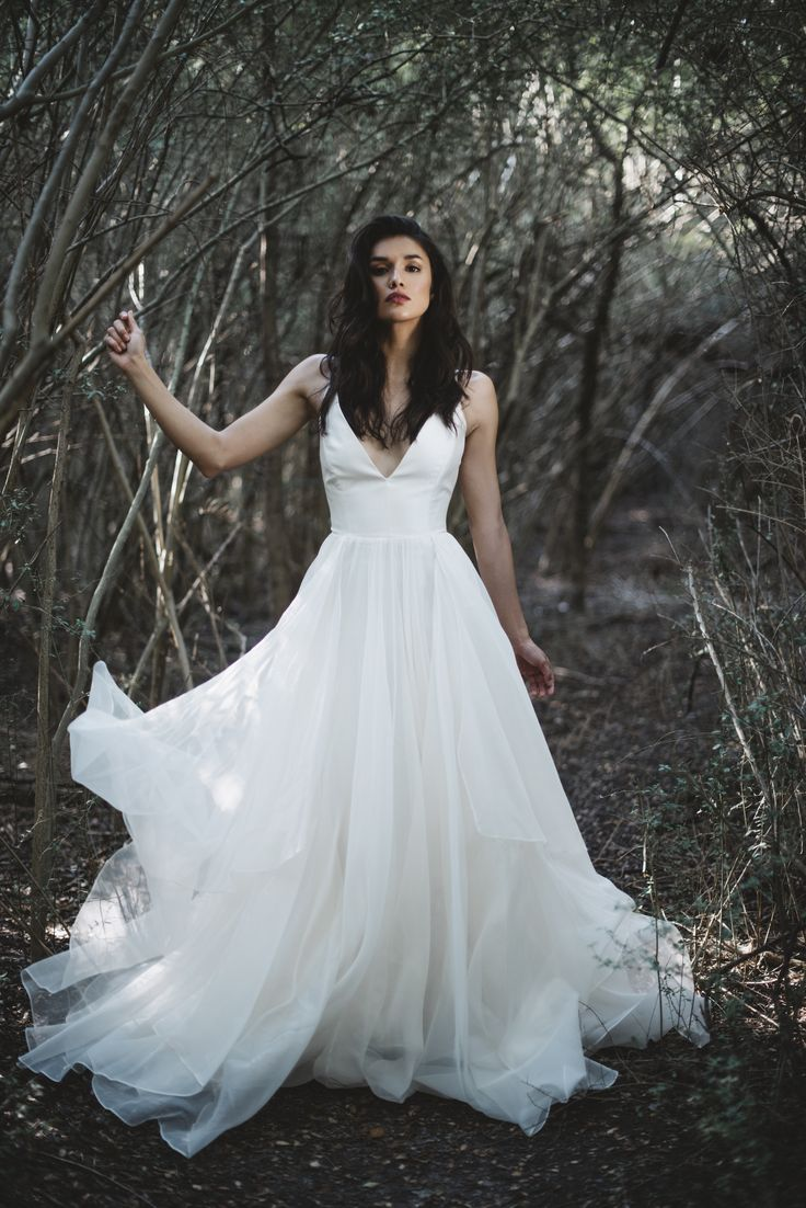 Leanne Marshall's sophisticated designs are known for their light, flowing lines, feminine details and timeless elegance. Each dress is handcrafted in the USA, which makes us love them even more. Shot by Morgan Chidsey exclusively for Lovely Bride.