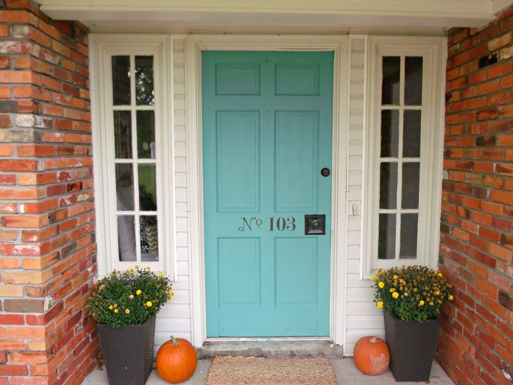 Aqua front door red brick house
