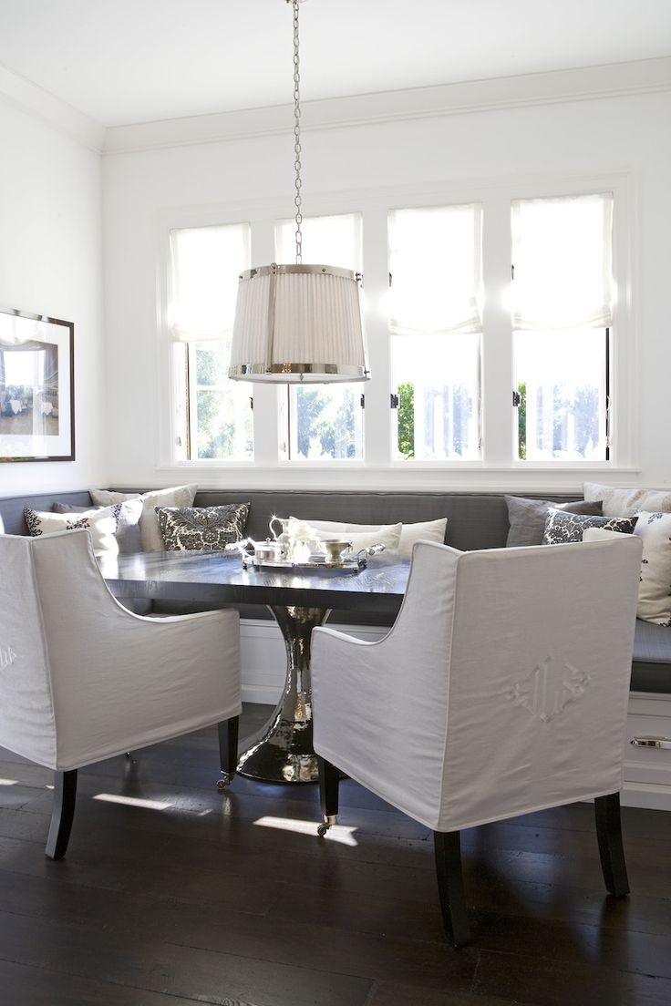 163 best interiors dining images on pinterest dining room chic dining nook features robert abbey chase pendant illuminating built in banquette doubling as window seat dressed in gray cushions paired with gray