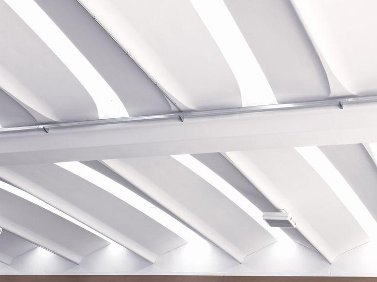 Il sistema Aliant si compone di tegoli alari in calcestruzzo armato precompresso alternati da lucernari zenitali continui in policarbonato. Una copertura immediatamente riconoscibile per il suo profilo curvilineo all'estradosso, la sezione scatolare chiusa e un esclusivo sistema di impermeabilizzazione in fibrocemento Baraclit.