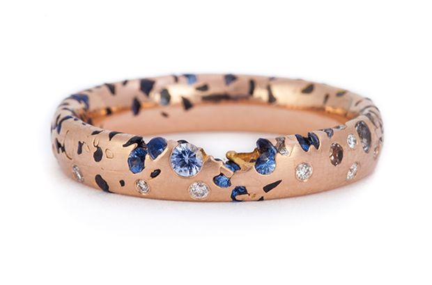 """This is Polly Wales' narrow blue ombre """"Confetti"""" ring with sapphires and diamonds in 18-karat rose gold ($5,060)."""