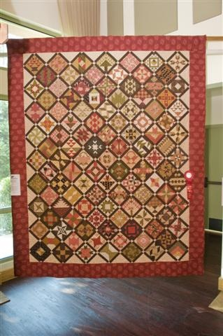 Farmer's wife quilt. Love the hint of muted red.: