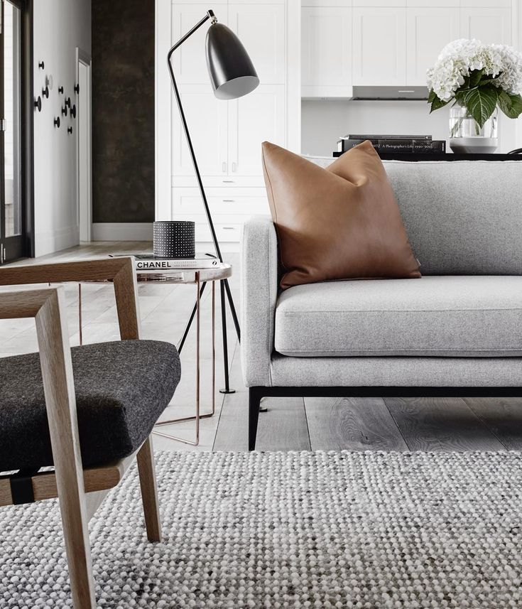 Dreamy Scandinavian chic interiors with the Gubi Grashoppa floor lamp as the perfect reading or ambient light.