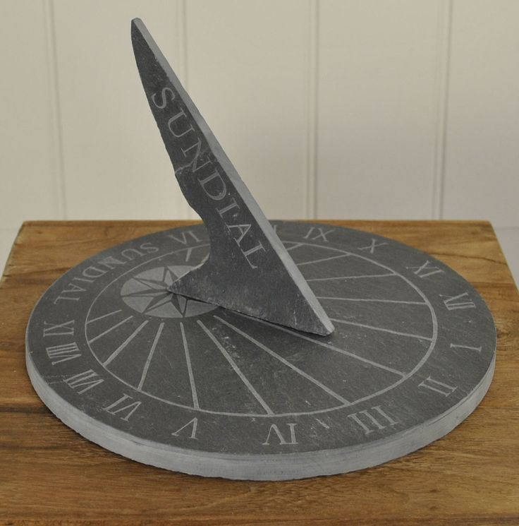 This lovely large round slate sundial from Fallen Fruits features traditional Roman Numerals and makes a lovely garden feature. Slate makes an excellent material for a sundial and, of course, even if the sun fails to shine this summer, its natural hardiness will stand up to the worst of the British weather, year after year. | eBay!