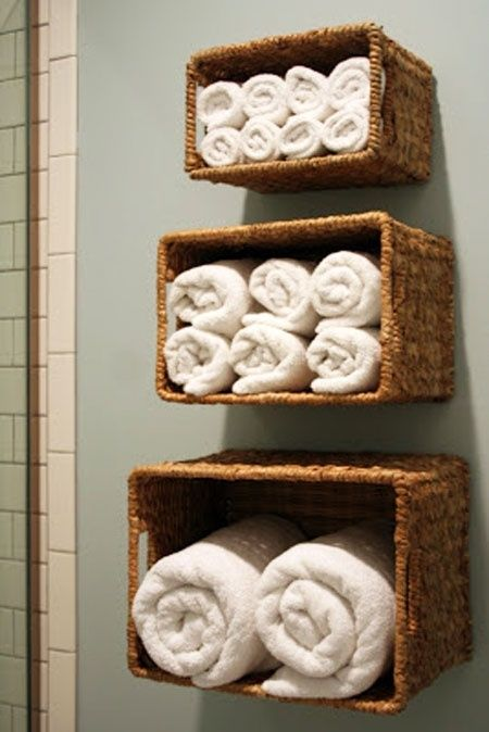 Bathroom Towel Storage Ideas: Another way to take advantage of vertical space is by hanging baskets on the wall above the toilet or tub and using them to store towels. by charlotte