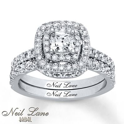 A cushion-cut diamond is bordered by tiers of round diamonds to form the mesmerizing center of the engagement ring in this bridal set from the Neil Lane Bridal® collection. More diamonds adorn the wedding band for a total diamond weight of 1 5/8 carats. The set is crafted in 14K white gold and features Neil Lane's signature along the inside of the bands. Diamond Total Carat Weight may range from 1.58 - 1.68 carats.