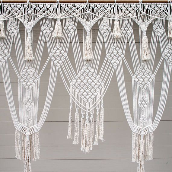 This large handmade macrame design is perfect for a wedding backdrop or it can be hung on a window or on a wall. This beautiful macrame backdrop is made from 6mm diameter natural cotton rope. It is 200cm (79) wide and 200cm (79) long. It is strung to rope, and can be easily attached