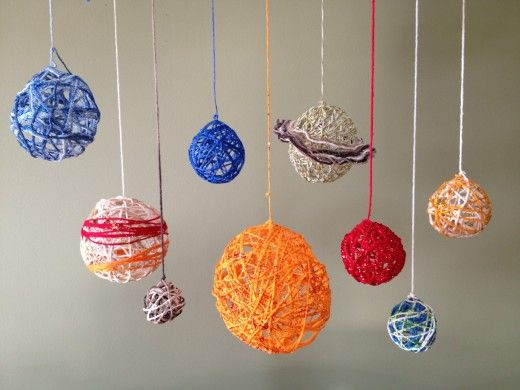 Solar System Projects: Mini Clay, Paper Mache, and Yarn Ball.  Detailed descriptions on how-to for kids to make solar system models.