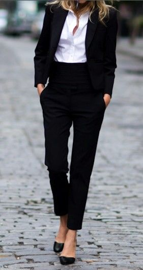 black fitted high-waist pants, white oxford shirt, black blazer, pointed toe shoes, and flats.