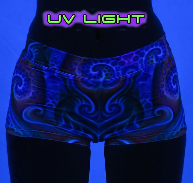 """Sublime Hot Pants : Holographic Altar  Hot ! Hot ! Hot ! Sublimation print hot pants with wide waistband & all over print.  The design is printed using dye sublimation technology on a high quality, 4-way stretch, polyester lycra. This gives extremely juicy, vibrant colors that will never fade away, no matter how many times they get washed, & results in an extremely soft """"feel"""" to the garment for ultimate comfort.  Polyester lycra (82% polyester, 18% spandex)  Artwork by Fabian Jimenez"""