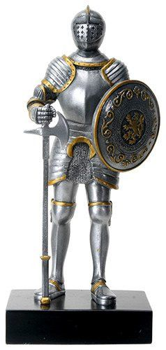 A English knight stands at attention in full armor with sword in this statue…