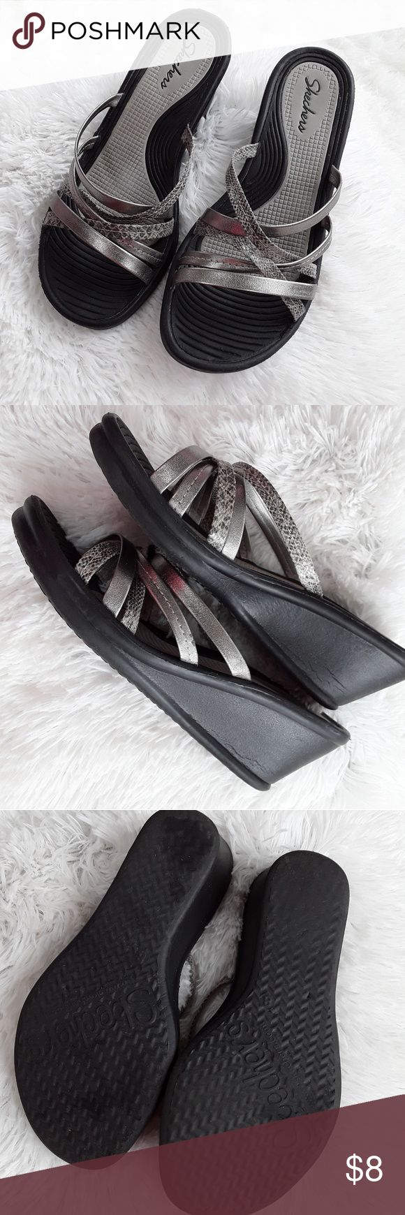 Skechers Wedge Sandals Cushy soft rubber wedge with silver and snakeskin look straps. Size 8 fits wide. Really comfortable. Wear on heels but still some life left in them. Skechers Shoes Wedges