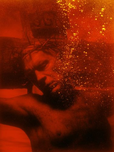 "Ask yourself. Are you ""comfortable with being uncomfortable?"" If you think you already are, or not sure, question your own beliefs by the work of Andres Serrano. https://en.wikipedia.org/wiki/Andres_Serrano"