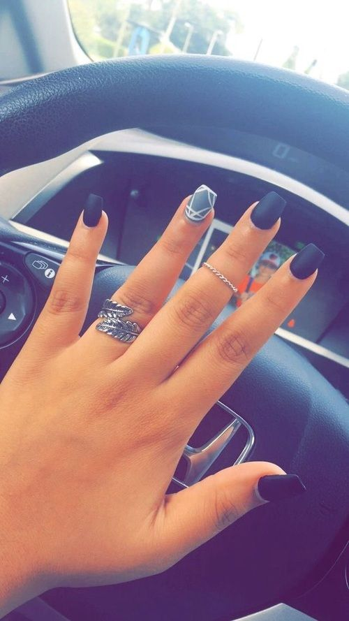 Matte black with a gray and white geometric accent nail