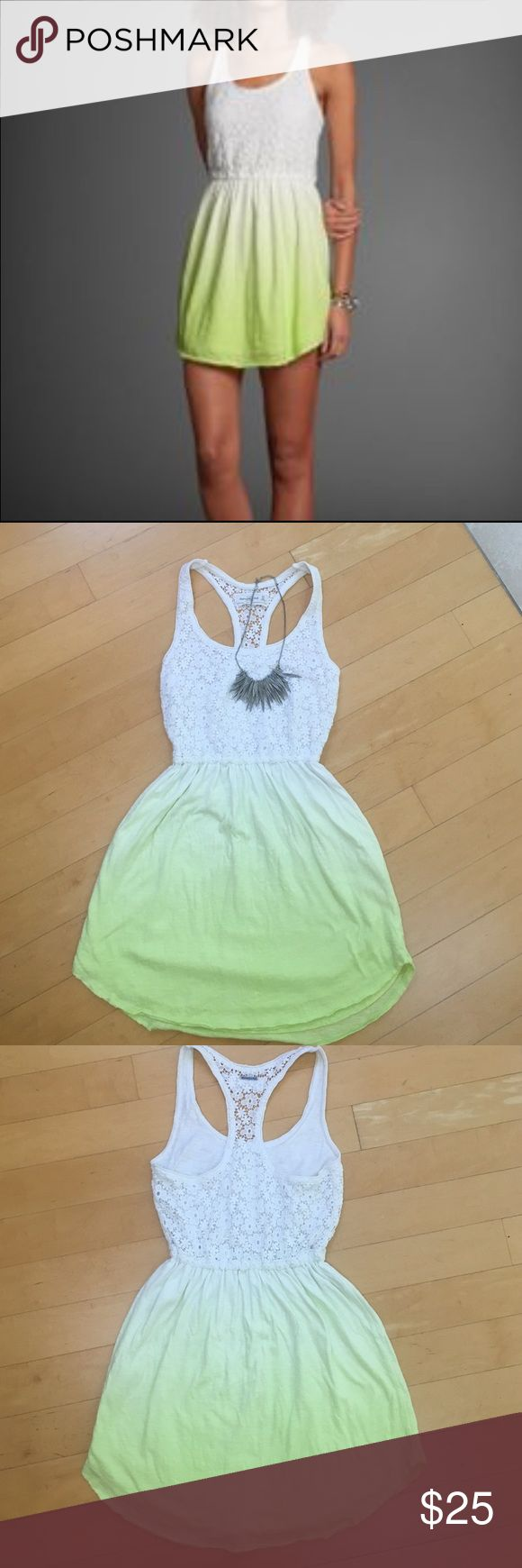 """Neon Ombré Dress You know when you want to look cute but you also want to be super comfortable? This dress is the answer! The floral patterned crochet lace on the bodice so pretty. Racerback style with lining in the front and elastic waist. The bottom half of the dress is an ombré pattern of white and neon green. It's made from a double lined T-shirt like material so it's not see through. Raw edge shirt tail hem. 14"""" across and 28"""" long at its shortest and 30.5"""" at the longest point…"""