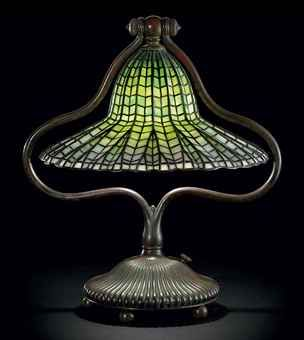TIFFANY STUDIOS A 'LOTUS BELL' LEADED GLASS AND BRONZE TABLE LAMP, CIRCA 1910