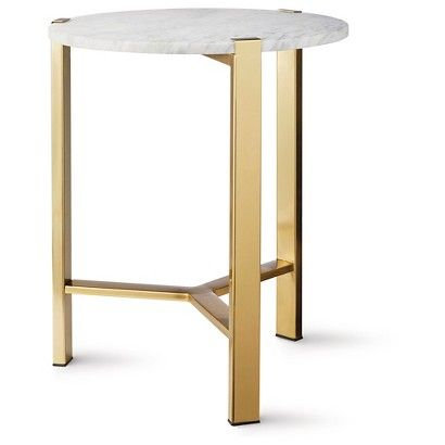 If you need a nice accent table this would bring in some of your gold and a table like this can be used anywhere. Round Gold Accent Table with Marble Top: