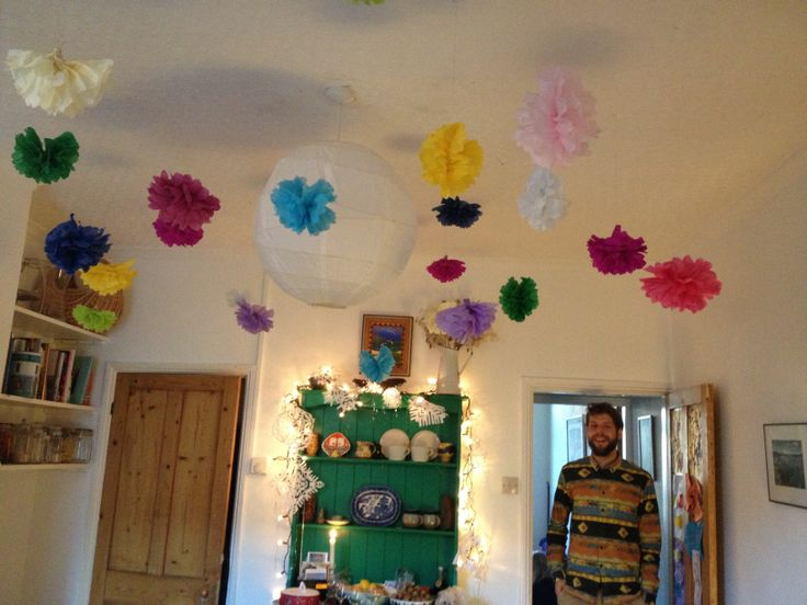 My colourful Christmas paper pom-poms, we liked them so much we've kept them up!