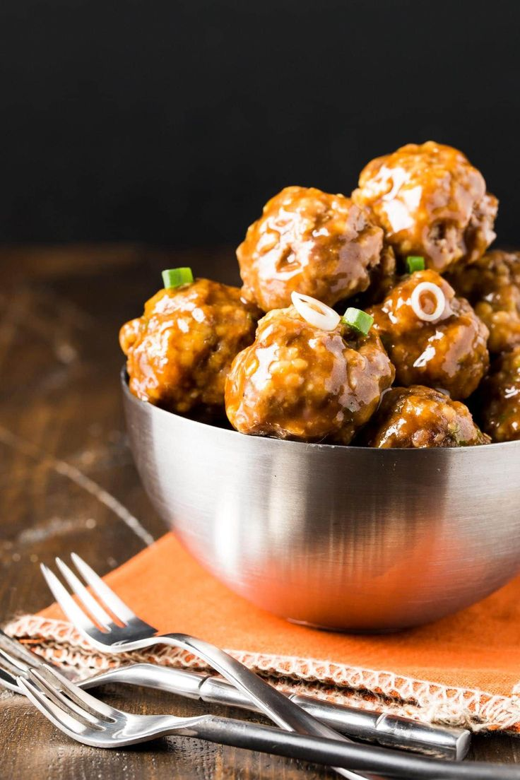 Comfort food alert! These Saucy Asian Meatballs can easily be made in advance - even frozen - & are guaranteed to be devoured. Great party food!