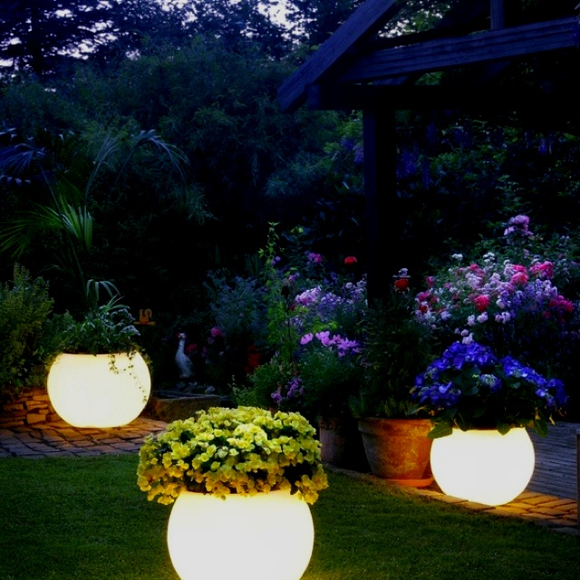 38 Innovative Outdoor Lighting Ideas For Your Garden: Glowing Flower Pots. Paint Flower Pots With Rustoleum's