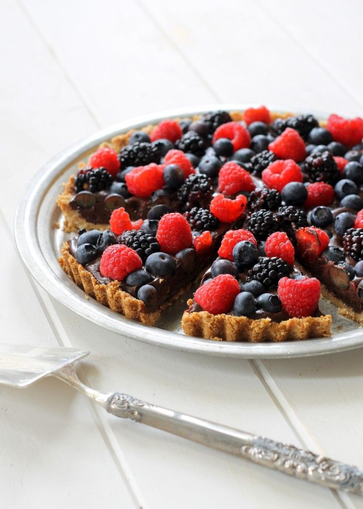 This Chocolate Berry Tart has chocolate ganache in an almond flour crust, topped with fresh berries! It is paleo, gluten-free, vegan and refined sugar-free.