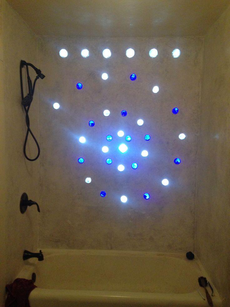 Glass bottle wall in shower.