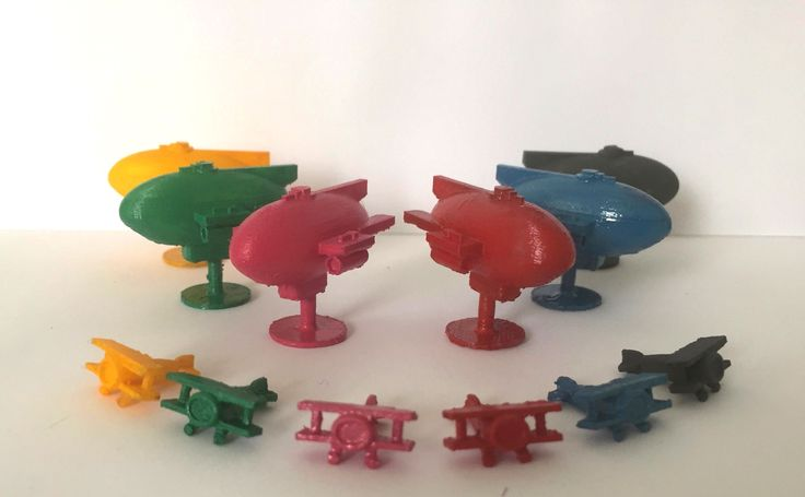 Game pieces of 'Air Ships' and 'Planes' for the new board game: Empire 1919.