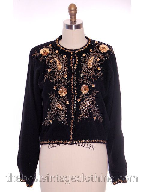 Pretty vintage black lambswool/rabbit hair/nylon blend cardigan, loads of gold colored bling in the form of paisleys of sequins and beads. Very 1950s! Even the cuffs have the same beading. Body is lin