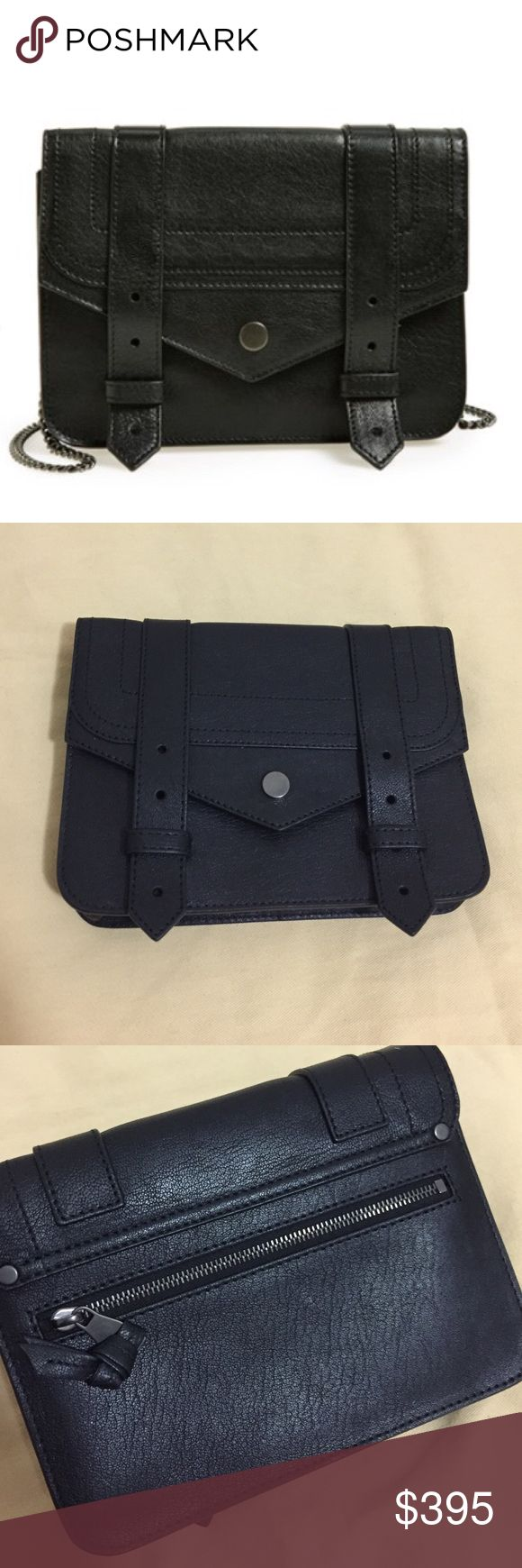Proenza Schouler 'Large PS1' Crossbody Wallet 💯 AUTHENTIC. GENTLY USED. *MISSING THE STRAP* But can be used as a clutch or wallet. Or you can order from Proenza. Light scratches on leather, interior is clean. No box or dust bag. Magnetic-snap flap and pull-through strap closures. Optional drop-in chain strap. Exterior zip pocket; slip pocket underneath flap. Interior zip and smartphone pockets; six card slots; mirror underneath flap. Lambskin leather. By Proenza Schouler; made in Italy. 7…