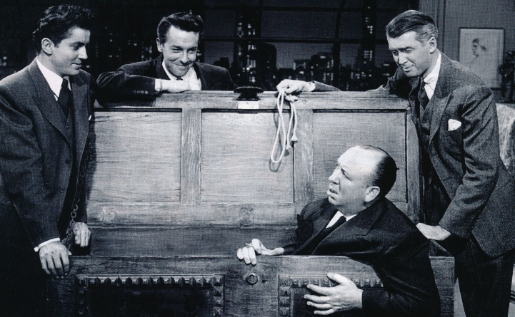 John Dall, Farley Grange, Jimmy Stewart and Alfred Hitchcok on the set of Rope. 194.