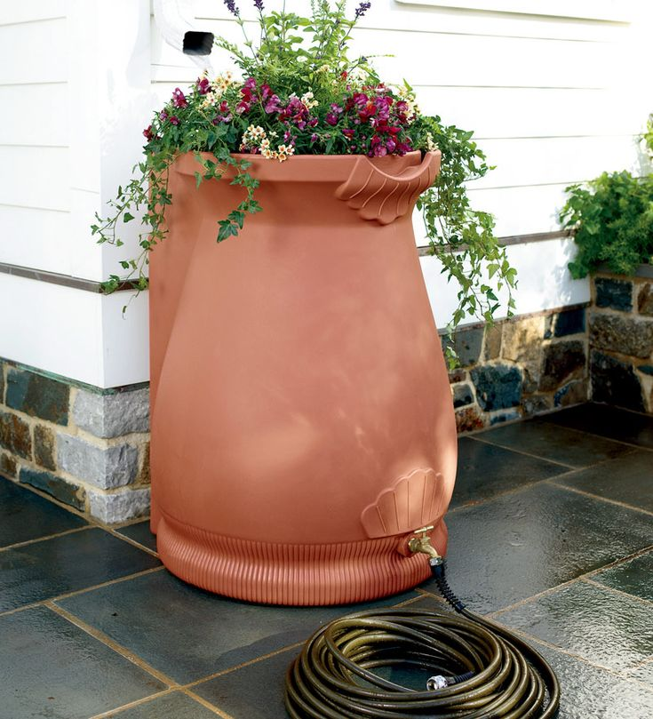 Go green! Capture and store rain water, then recycle it during dry spells to water your plants using the attached hose spigot.