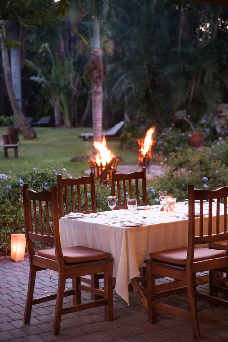 Enjoy your dinner outside in the gardens surrounded by the fire and the sounds of the birds. #SefapaneMagic