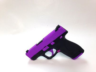 This is a Purple S&W M&P Shield 9mm handgun! This is a great custom piece for the ladies out there! - www.tzarmory.com