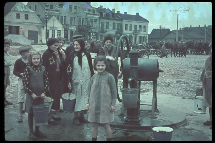 World War II Erupts: Color Photos From the Invasion of Poland, 1939. Jewish women and children in Gostynin, Poland, after the German invasion, 1939.