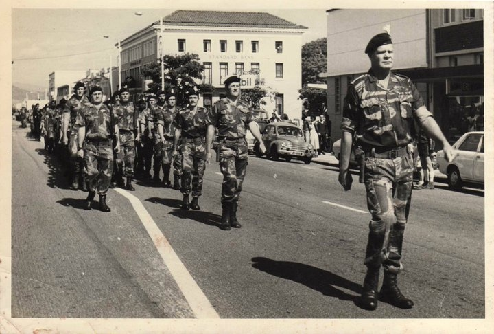 Peter Garratt collection. This fine body of men is F Coy 4th Battalion Rhodesia Regiment. They are part of the Freedom Of Umtali celebrations circa 1976. Maj 'Buster' Johnson, followed by 2 I/C Capt Paddy Bomford and behind him on the left is CSM Malcolm Forbes BCR.