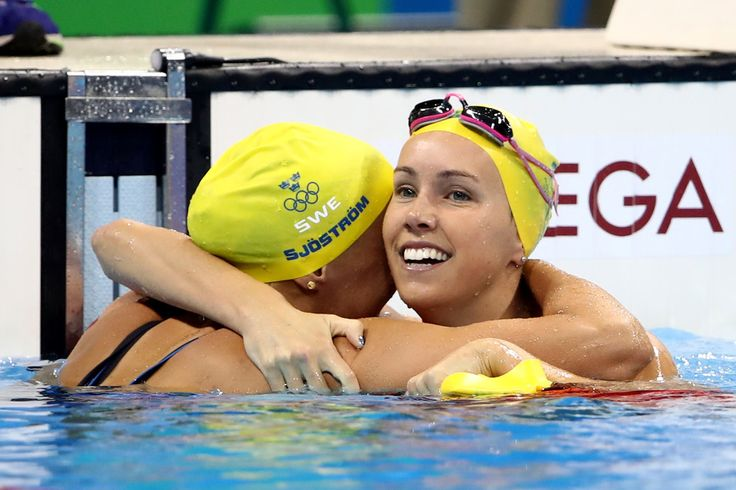 Emma McKeon (R) of Australia congratulates gold medal winner Sarah Sjostrom of Sweden after the Women's 100m Butterfly Final on Day 2 of the Rio 2016 Olympic Games at the Olympic Aquatics Stadium on August 7, 2016 in Rio de Janeiro, Brazil.